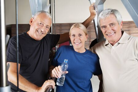 Active smiling senior fitness group in a gym photo