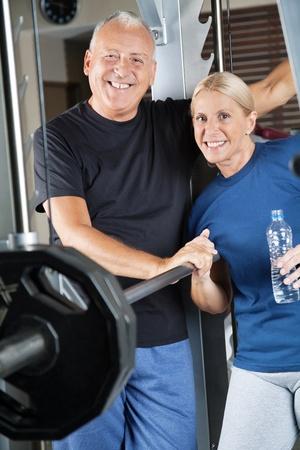 Happy smiling senior couple exercising in fitness center Stock Photo - 12954766
