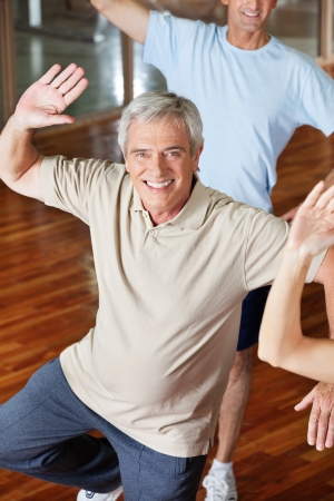 aerobic training: Dancing elderly man in fitness center class Stock Photo