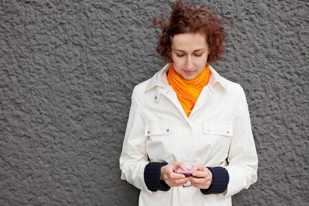 Young attractive woman using her smartphone outdoors photo