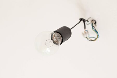 Old light bulb hanging on a ceiling Stock Photo - 13108447