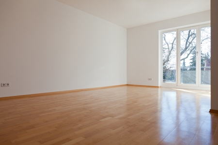 Empty room with white walls in a house photo