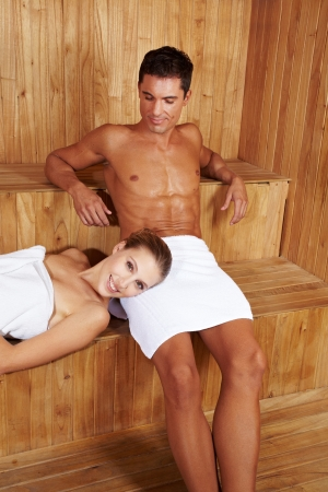 Happy couple relaxing together in a sauna Stock Photo - 13713187