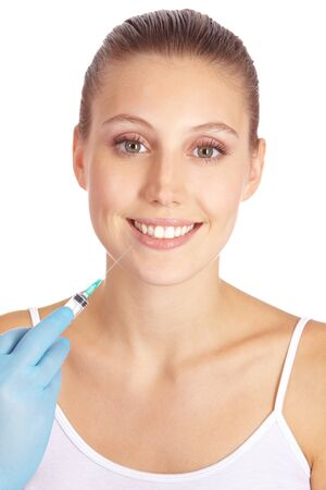 augmentation: Smiling woman getting lip augmentation with syringe Stock Photo