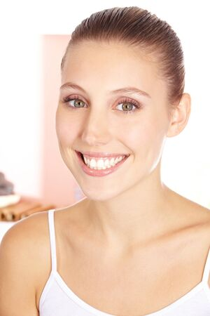 Happy smiling woman with perfect skin in beauty salon photo