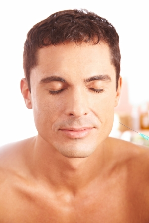 13713080: Attractive man getting treatment with syringe in beauty clinic Stock Photo