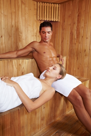 hot love: Man and woman enjoying relaxation in a sauna Stock Photo