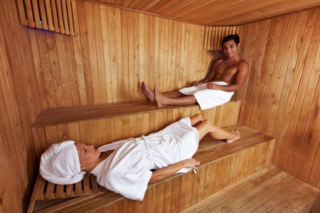 Man and woman together in a mixed sauna photo