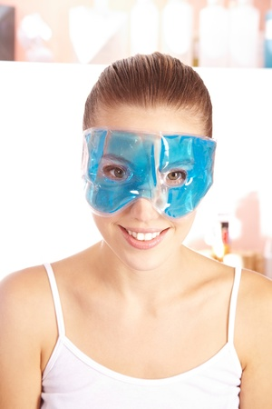 eye mask: Smiling young woman with refreshing gel mask in her face