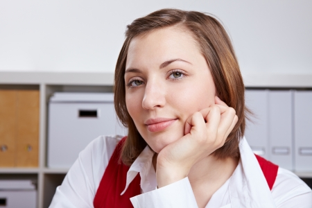 Portrait of attractive young business woman in her office photo