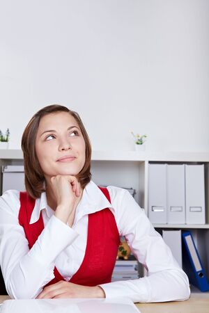 clueless: Attractive woman in office thinking and looking up