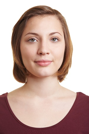 Frontal portrait of brunette woman with blank expression photo