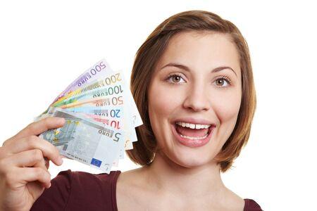 Happy woman holding fan of Euro money bills Stock Photo
