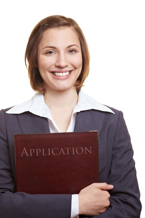testimony: Smiling female applicant holding application folder in her hands Stock Photo
