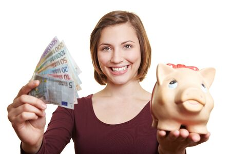 bank notes: Happy woman holding Euro money bill fan and piggy bank