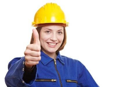 man's thumb: Happy female worker in overall holding thumbs up