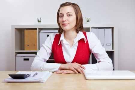 Friendly female Human Resource manager doing job interviews at her desk photo
