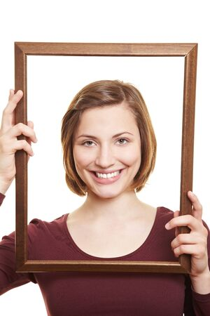 self conceit: Happy attractive woman in empty wooden picture frame
