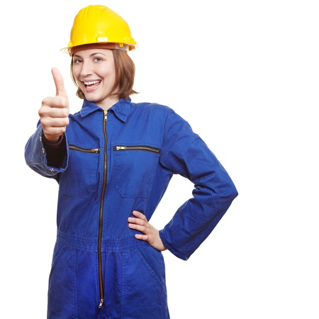 man's thumb: Cheering female worker in boiler suit showing thumbs up
