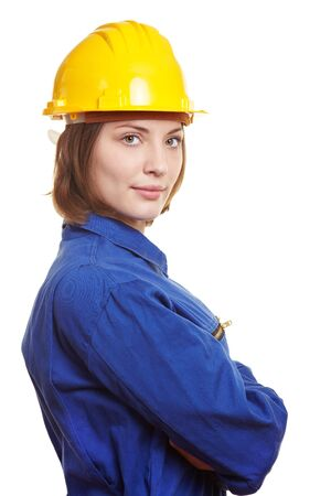 boiler suit: Female builder with blue boiler suit and yellow safety hardhat