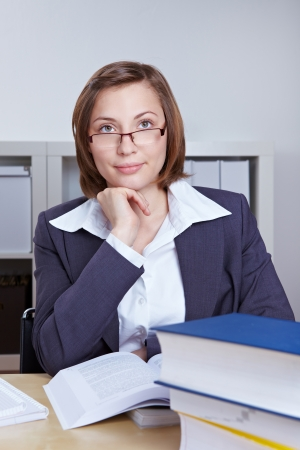 Female lawyer studying books in her office photo