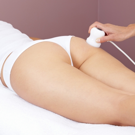 thigh: Woman getting electrical massage for muscle stimulation at buttocks Stock Photo
