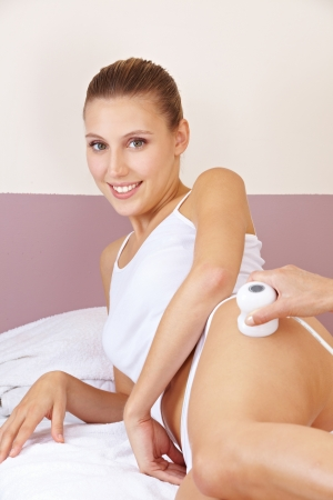 electronically: Relaxed woman getting skin tightening with electric massage in spa