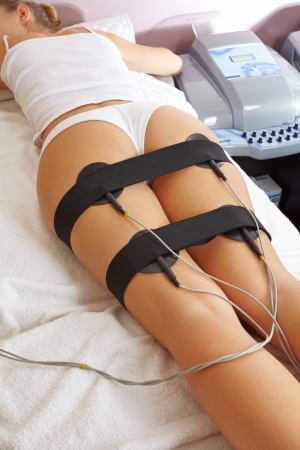 electronically: Woman getting electrical muscle stimulation in spa Stock Photo