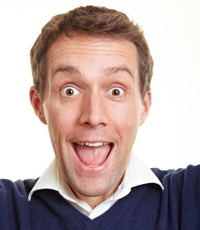 frontal: Cheering happy man looking really happy into the camera Stock Photo