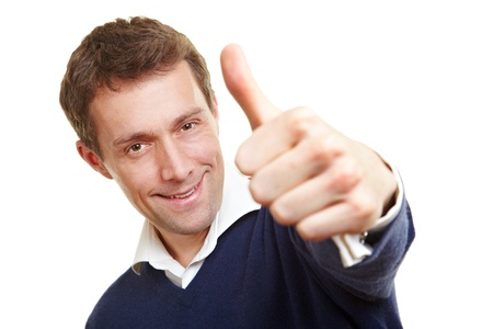Smiling confident man holding his thumb up photo