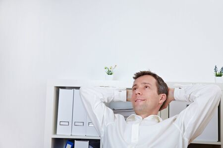 perplexity: Relaxed business man leaning back in his office Stock Photo