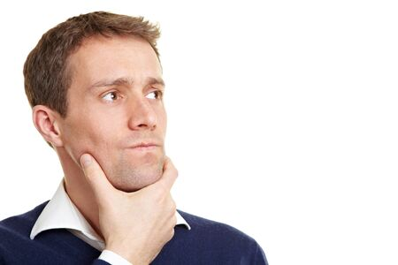 Man thinking thoughful with his hand on the chin
