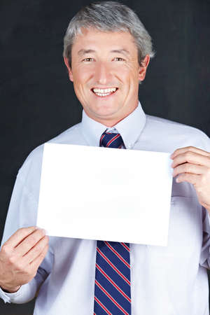 Happy elderly business man holding empty white sign photo