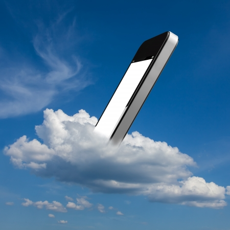 Smartphone in the blue sky on a white cloud photo