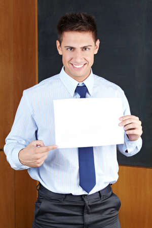 Happy business man holding an empty white sign photo