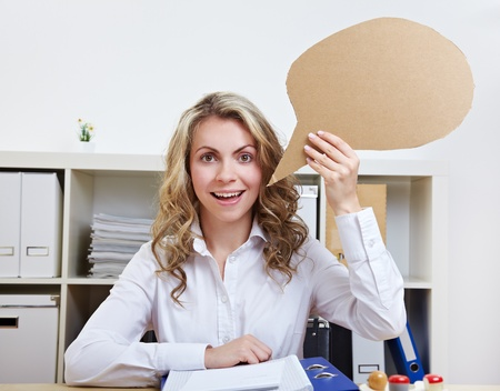 Business woman holding empty cardboard speech balloon in her hand photo