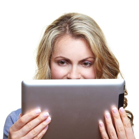 Blonde woman reading a digital book with an ebook reader Stock Photo - 14754567