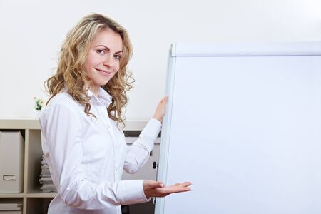 sales manager: Smiling happy business woman holding a presentation with a flipchart Stock Photo