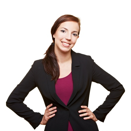 arms akimbo: Smiling attractive business woman holding her arms akimbo
