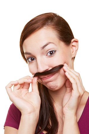 fake: Young woman using hair streak as a fake mustache
