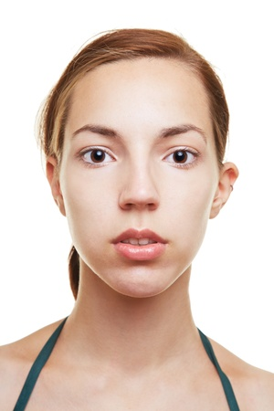 frontal: Young woman with blank expression on her face Stock Photo