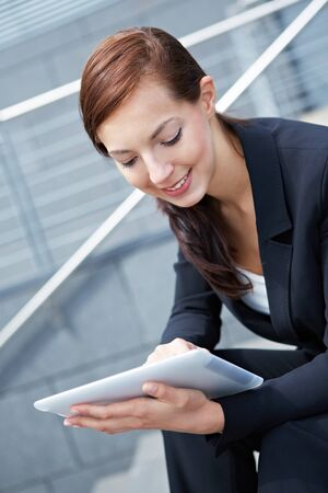 Businesswoman sitting with Digital Tablet Computer on stairs Stock Photo - 14903315