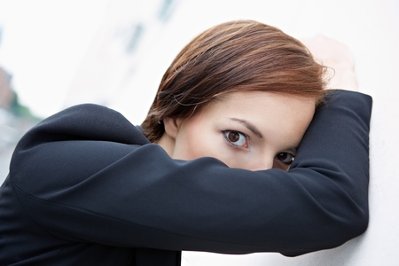 shy woman: Shy business woman hiding behind her arm