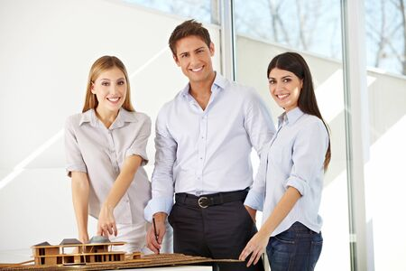 Happy architects business team in office with building model Stock Photo - 15455449