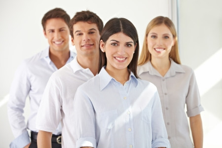 Smiling successful business team standing in a row Stock Photo - 15455445