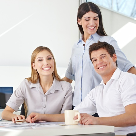 Happy business team working together in an advertising agency Stock Photo - 15475326