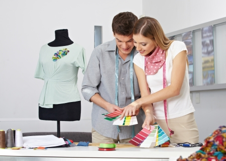 alteration shop: Two fashion designer making color choice with color samples in their studio Stock Photo