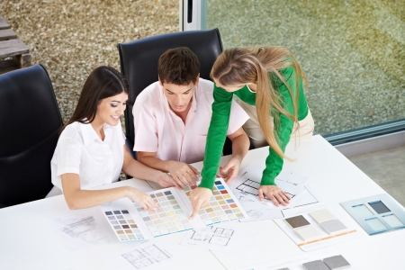 Happy couple discussion building materials with architect in her office Stock Photo - 15461899