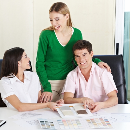 architectural firm: Happy couple getting advice for building materials from female architect Stock Photo