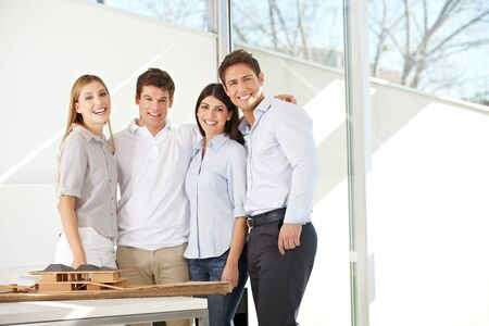 Happy business architects team together in their office photo
